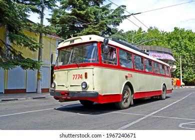ALUSHTA, CRIMEA, UKRAINE - JUN 01, 2013: Crimean vintage trolleybus Shkoda 9Tr on the road on June 01, 2013 in Alushta, Crimea. Shkoda 9Tr was the most popular model in the USSR.