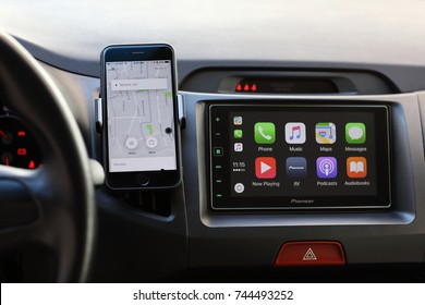 Alushta, Russia - April 20, 2017: iPhone with application Taxi Uber and Car Play on the screen. iPhone was created and developed by the Apple inc.