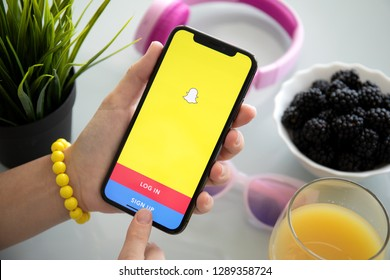 Alushta, Russia - July 27, 2018: Woman holding iPhone with social networking service Snapchat on the screen. iPhone X was created and developed by the Apple inc.