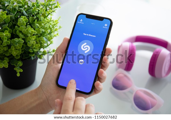 Alushta, Russia - July 27, 2018: Woman hand holding iPhone X with music service Shazam on the screen. iPhone 10 was created and developed by the Apple inc.