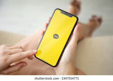 Alushta, Russia - July 29, 2018: Woman hand holding iPhone X with social networking service KakaoTalk on the screen. iPhone ten was created and developed by the Apple inc.