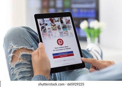 Alushta, Russia - June 8, 2017: Man holding iPad Pro Space Gray with social Internet service Pinterest on the screen. iPad Pro was created and developed by the Apple inc.