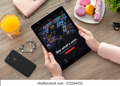 Alushta, Russia - November 17, 2016: Woman holding iPad Pro Space Gray with multinational entertainment company Netflix provides streaming media and video on the screen.