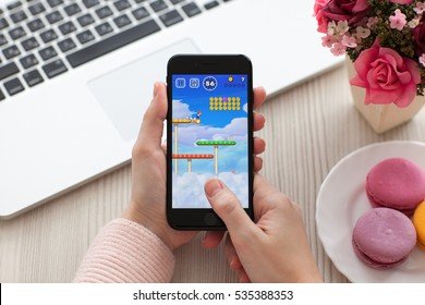 Alushta, Russia - November 19, 2016: Woman hand holding iPhone 7 Jet Black with game Super Mario Run in the screen. Games Super Mario Run was created and developed by the Nintendo.