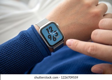 Alushta, Russia - November 3, 2018: Man hand with Apple Watch Series 4 with Nike Watch Face on the screen. Apple Watch was created and developed by the Apple inc.