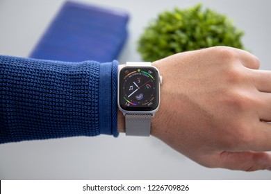 Alushta, Russia - November 3, 2018: Man hand with Apple Watch Series 4 in the home. Apple Watch was created and developed by the Apple inc.