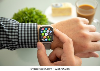 Alushta, Russia - November 6, 2018: Man hand with Apple Watch Series 4 in the home. Apple Watch was created and developed by the Apple inc.