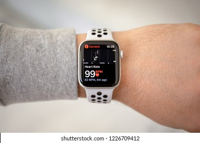 Alushta, Russia - November 6, 2018: Man hand with Apple Watch Series 4 with Heart Rate on the screen. Apple Watch was created and developed by the Apple inc.