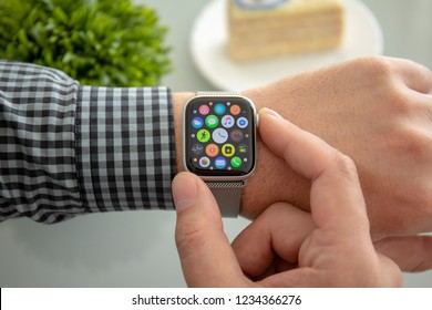 Alushta, Russia - November 6, 2018: Man hand with Apple Watch Series 4 over the table. Apple Watch was created and developed by the Apple inc.