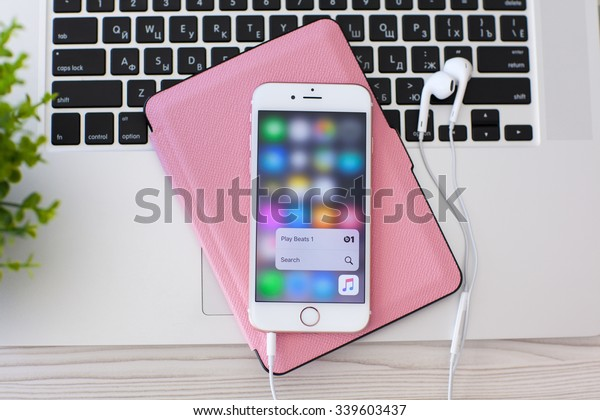 Alushta, Russia - October 27, 2015: iPhone6S Rose Gold with function 3D Touch and app Apple Music. iPhone 6S Rose Gold was created and developed by the Apple inc.