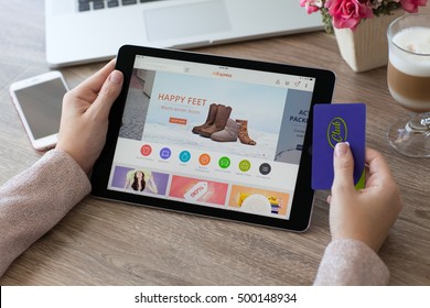 Alushta, Russia - October 9, 2016: Woman holding a iPad Pro with Internet shopping service Aliexpress on the screen. iPad Pro was created and developed by the Apple inc.