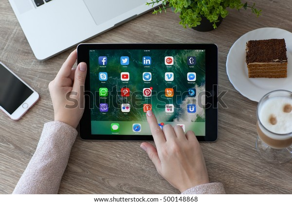 Alushta, Russia - October 9, 2016: A set of programs from famous brands of social networking on the iPad Pro in woman hands. iPad Pro 9.7 was created and developed by the Apple inc.
