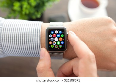 Alushta, Russia - September 1, 2015: Man hand with Apple Watch and app Icon on the screen. Apple Watch was created and developed by the Apple inc.