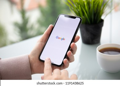 Alushta, Russia - September 24, 2018: Woman holding iPhone X with social networking service Google on the screen. iPhone was created and developed by the Apple inc.