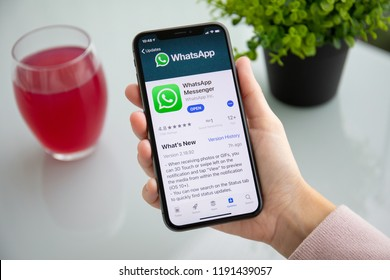 Alushta, Russia - September 24, 2018: Woman holding iPhone X with social networking service WhatsApp on the screen. iPhone 10 was created and developed by the Apple inc.