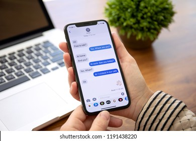 Alushta, Russia - September 26, 2018: Woman hand holding iPhone X with social networking service iMessage on the screen. iPhone 10 was created and developed by the Apple inc.