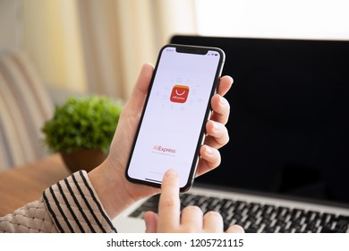 Alushta, Russia - September 26, 2018: Woman holding iPhone X with Internet shopping service Aliexpress on the screen. iPhone 10 was created and developed by the Apple inc.