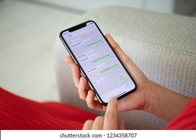Alushta, Russia - September 27, 2018: Woman holding iPhone X with social networking service WhatsApp on the screen. iPhone 10 was created and developed by the Apple inc.