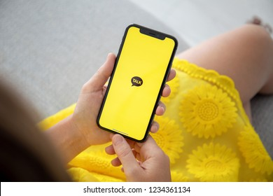 Alushta, Russia - September 27, 2018: Woman hand holding iPhone X with social networking service KakaoTalk on the screen. iPhone 10 was created and developed by the Apple inc.