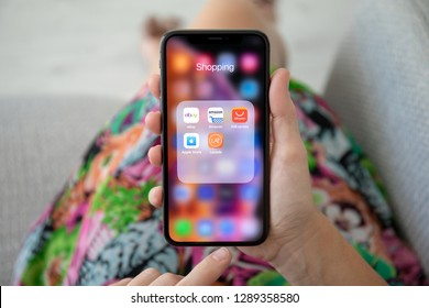 Alushta, Russia - September 27, 2018: Woman holding iPhone X with TOP Internet shopping service on the screen. iPhone ten was created and developed by the Apple inc.