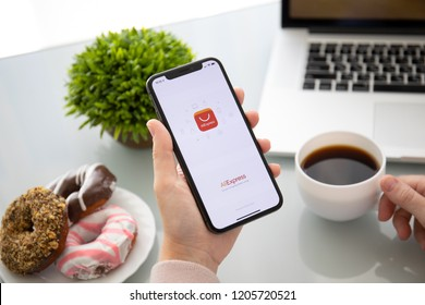 Alushta, Russia - September 28, 2018: Woman holding iPhone X with Internet shopping service Aliexpress on the screen. iPhone 10 was created and developed by the Apple inc.