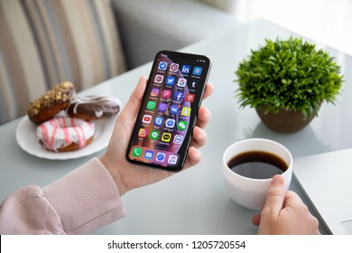 Alushta, Russia - September 28, 2018: Woman holding iPhone X with social networking Messenger on the screen. iPhone 10 was created and developed by the Apple inc.