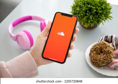 Alushta, Russia - September 28, 2018: Woman holding iPhone X with music service SoundCloud on the screen. iPhone 10 was created and developed by the Apple inc.
