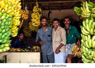 Aluva, India - May 15, 2018 : Men selling banana in a street market in the city of Aluva in Kerala, India.