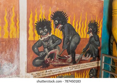 ALUVIHARE, SRI LANKA - JULY 20, 2016: Gruesome paintings depicting hell punishments in a cave at Aluvihare Rock Temple, Sri Lanka