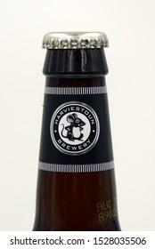 Alva, Scotland - October 9, 2019: Bottleneck of a Harviestoun Schiehallion beer bottle.