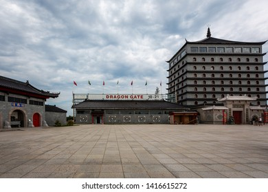 ALVKARLEBY, SWEDEN - JULY 27, 2014: Front view of a traditional Chinese building and square at Dragon Gate. Entrance and hotel building with cloudy sky at Alvkarleby Sweden July 27, 2014.