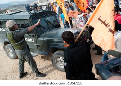 AL-WALAJA - NOVEMBER 13: Palestinian activists confront Israeli soldiers in a protest against the Israeli separation wall on Nov. 13, 2010 in Al-Walaja.