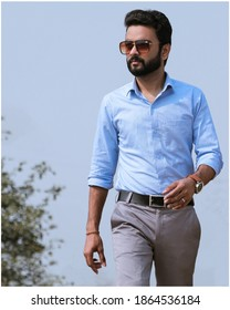 alwar city, rajasthan. 11-25-2020. Indian male model in formal dress walking pose, wearing light blue shirt and light grray pant, male model with good beard look.