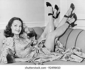 Always nice to have a spare, a young woman sits on her sofa with four legs