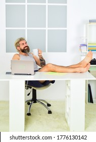 Always wanted to work from home. Lockdown self isolation and quarantine. Barefoot guy working from home. Man work laptop. Comfortable workplace. Social networks. Social distancing. Too lazy to work.