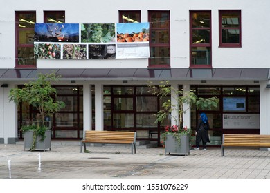 ALZENAU, GERMANY - OCTOBER 16: A woman walks along the shop window of the culture forum, a public building on October 16, 2019 in Alzenau.