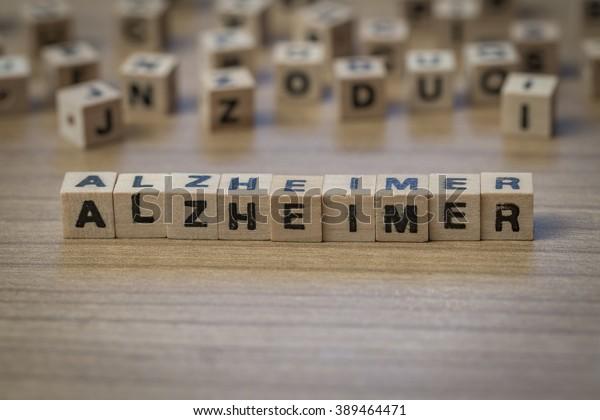 Alzheimer (German Alzheimer's) written in wooden cubes on a table