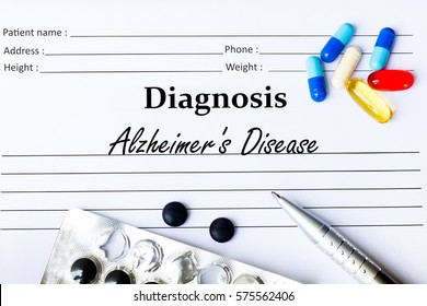 Alzheimer's Disease - Diagnosis written on a piece of white paper with medication