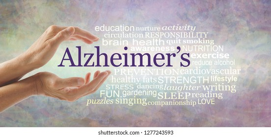 Alzheimer's Word Cloud - female hands gently cupped around the word ALZHEIMER'S and a relevant word cloud on a pale rustic   background