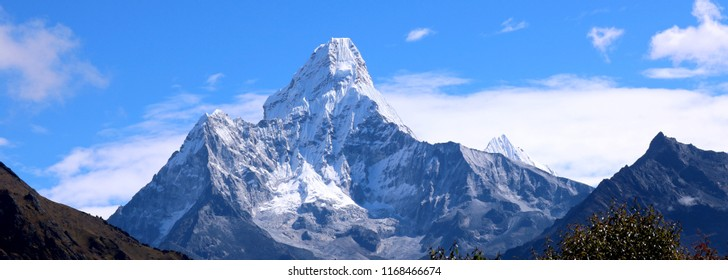 Ama Dablam is a mountain in the Himalaya range of eastern Nepal. The eastern sky for anyone trekking to Mount Everest basecamp. Ama Dablam main peak is 22,349 ft, the lower western peak is 20,243 ft.