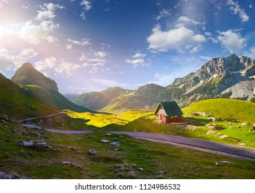 Amaizing sunset view on Durmitor mountains, National Park, Mediterranean, Montenegro, Balkans, Europe.  Bright summer view from Sedlo pass. Instagram picture. The road near the house in the mountains