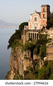 Amalfi Coast : church on a cliff directly above sea. Town Vico Equense