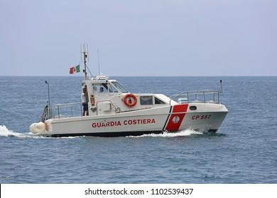 AMALFI COAST, ITALY - JUNE 28, 2014: Coast Guard Boat Patroling at Tyrrhenian Sea in Amalfi Coast, Italy.