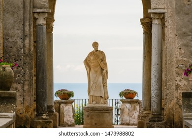 Amalfi Coast, Italy - May 2019: Arch with a statue at the entrance to the Terrace of Infinity or Terrazza dell'Infinito, Villa Cimbrone, Ravello  village,