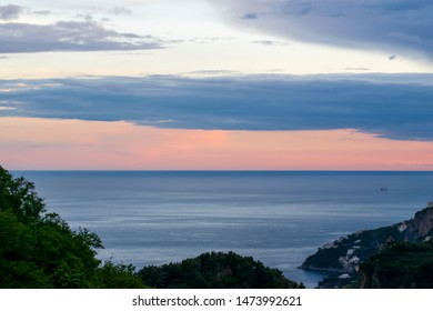 Amalfi Coast, Italy - May 2019: Sunset over the Tyrranean sea, viewed from The Terrace of Infinity or Terrazza dell'Infinito, Villa Cimbrone, Ravello village