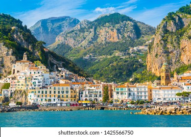 Amalfi, Italy - April 18, 2019: Panoramic view of Amalfi. Italian seaside town on coastline of Tyrrhenian Sea at sunny day.