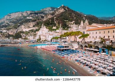 Amalfi, Italy - August 7: scenic view on Amalfi town beach with mountain on background on August 7, 2018.