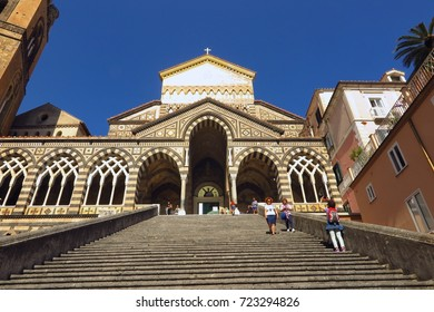 AMALFI, ITALY – MAY 29, 2017: Stone stairs lead upward to entrance of the 9th century Amalfi Cathedral in Amalfi Italy. The relics of Saint Andrew are kept here.