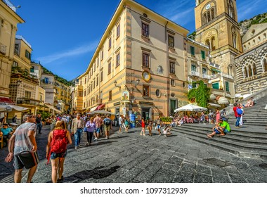 Amalfi, Italy - September 18 2016: The center of the town of Amalfi on the Amalfi Coast of Italy with the stairs leading up to the famous Amalfi Cathedral as tourists shop and dine