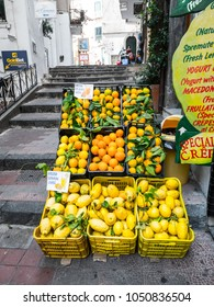 Amalfi, Italy - September 9th, 2017: Fresh and vibrant citrus fruit crates full of lemons and oranges sit outside a local shop in Amalfi Italy.
